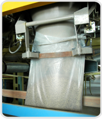 A bag being filled with adsorbent material
